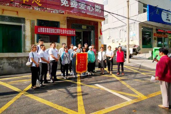 卫辉市道德模范史春荣对dafa大发手机版集团表示感谢